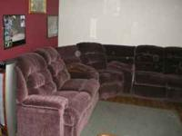Sectional sofa. Reclines at three places. Both ends and