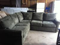 This is a stunning sectional. Microfiber material. No