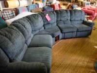 Large 2 piece couch with recliners at each end. Also