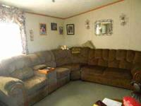 brown sectiontal couch with two recliners on on side