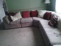 Sectional couch with hide a bed and extra pillows.