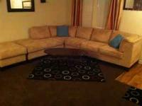 Ivory sectional with ottoman. $500.  Location: North