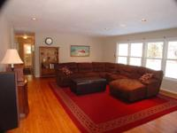 Brown sectional couch with 3 recliners 1 of them in a