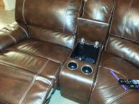 Leather sectional couch - less than 1 year old-