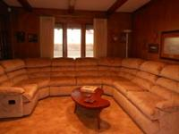 7 Pc Sectional Sofa w/1 Recliner and a hide a bed @