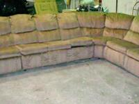 For sale: Beige colored sectional with a hide-a-bed and