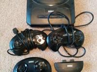 Sega Genesis with 2 wired and one cordless controller.
