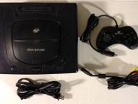 Sega genesis with sega cd attachment. Comes with cords