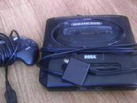 I have a Sega Genesis with 7 games for sale. Comes with
