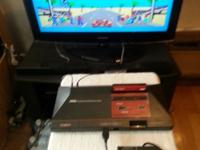 I am selling my Sega Game System, 2 Controllers, 2