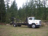 Self Loading grapple log/debris truck. 1992 Ford Aero