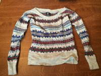 Offering lightly utilized women's t-shirts, coats,