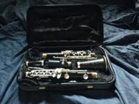 15 year old wood Bb Selmer Omega clarinet for sale. I