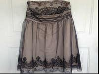 Classy beige and black dress. Size 6. Paid $220.00 for