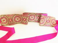 This  dress sash is made with pink rhinestones,