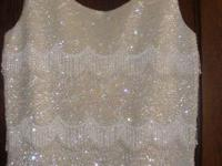 I have a beautiful white sequined & beaded camisole top