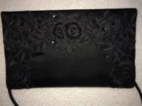 "Sequined evening bag.  Measures 8 1/2"" x 5"""