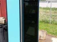 This is a heavy steel cabinet with a door on front and