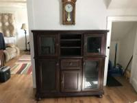 Very nice dark wood cabinet in excellent condition.Has