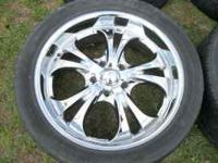 "Im selling a set of 22"" rims with tires. one of them"