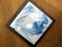 "Each trivet is 7""x7""x1"" and handmade from ceramic and"