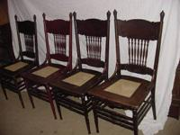 For sale is a set of four oak antique pressed back