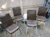 Set of four kitchen chairs, brown plastic cushioned