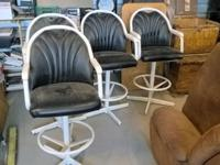 Set of 4 metal bar stools with vinyl cushioning As you