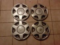 "USED set of 4 OEM 15"" wheel covers initially utilized"
