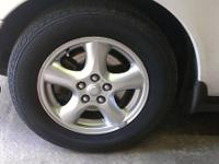 Set of 4 stock wheels off of a 2003 Ford Taurus.    Set