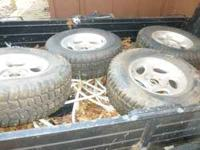 I have a set of 4 studded snow tires mounted on Ford
