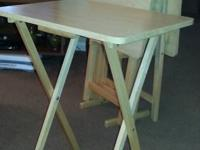 Set of 4 sturdy TV tables with stand $25.00 cash only.