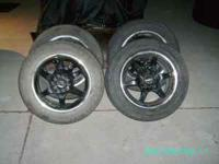 SET OF 4 WHEELS / TIRES (USED, NEW IN 2009). OFF OF A