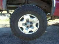 5 Goodyear Wrangler 31x10.50x15 tire mounted on Factory