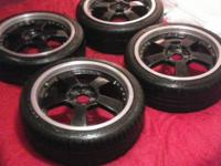 "Set of 4 Black 5 spoke with a silver lip 18"" rims on"