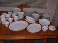 "There are 12 place settings, of "" PURITAN CHINA "" with"