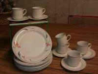 I have 6 plates with cups and saucers trimmed in blue