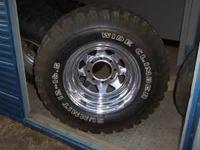 set of 5 chevy 8 lug chrome wheels, off road tires,