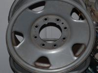 PRICE IS FIRM FOR A SET OF FOUR 8 LUG STEEL RIMS OFF OF