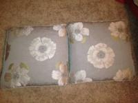 These are four very gently used flower throw pillows