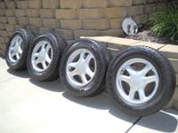 Set of four exceptional OEM wheels and tires for the