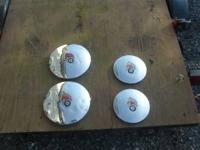 "Set of 4 Hubcaps for a Wheel Horse tractor 12'and 8""."
