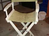 2 white Pier 1 director chairs with two chair covers,