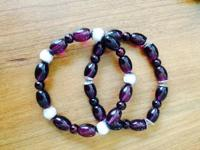 These bracelets are made from Bordeaux and pink acrylic