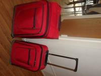 Set of two red suit cases in good condition if