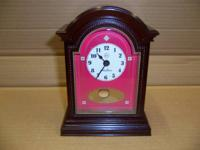 "This is a ""vintage"" Seth Thomas miniature desk clock."