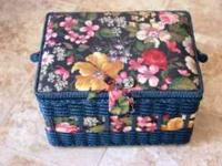 Nice sewing basket with padded top. Includes plastic