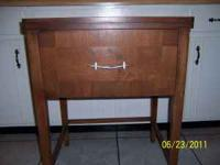 sewing cabinet dated june 1957 solid wood front opens