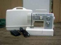 Necchi Sewing Machine with little use. Has a variety of