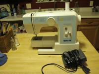 Sewing machine, White is the brand Works well Call  or